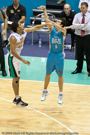 First game rookie Jason Cadee against 3 point specialist Michael Cedar - Gold Coast Blaze v Townsville Crocodiles NBL Basketball, Friday 17 December 2010 - National Basketball League, Gold Coast Convention & Exhibition Centre, Queensland, Australia. Photos by Des Thureson.