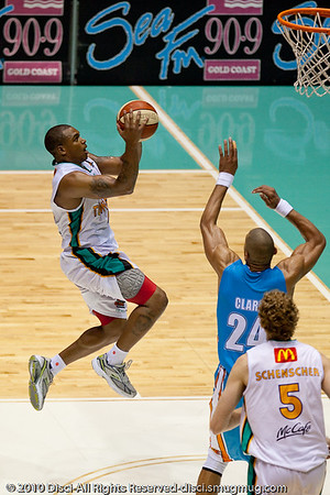 Will Blalock elevates nicely against Ira Clark - Gold Coast Blaze v Townsville Crocodiles NBL Basketball, Friday 17 December 2010 - National Basketball League, Gold Coast Convention & Exhibition Centre, Queensland, Australia. Photos by Des Thureson.