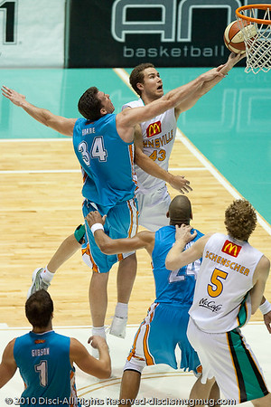 Former Brisbane Bullets Championship guard Brad Williamson is fouled by NBL Veteran Stephen Hoare - Gold Coast Blaze v Townsville Crocodiles NBL Basketball, Friday 17 December 2010 - National Basketball League, Gold Coast Convention & Exhibition Centre, Queensland, Australia. Photos by Des Thureson.
